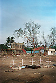 Five make-shift graves, marked by crucifixes, stand on the beach in the northeastern coast of Sri Lanka, an area ravaged first by civil war then by the tsunami. The crosses mark the deaths of a woman and her four children..The December 26, 2004 tsunami killed around 40,000 people along Sri Lanka's southern, eastern and northern shores, tearing thousands of families apart. .The bulk of the dead were women and children - husbands lost young brides and around 4,000 children lost one or both parents. .Even before the tsunami struck, people here in the northeast had already been displaced four times by the Tigers' two-decade war for autonomy. .In some places, the scars of war and the tsunami have become one. Remnants of walls torn down by waves are pockmarked with bullet holes and shrapnel from shells fired before a 2002 ceasefire plunged a civil war that killed over 64,000 people into limbo. .
