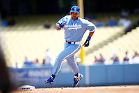 4 May 2011: James Loney rounds second base.  The Cubs defeated the Dodgers 5-1 during a Major League Baseball game at Dodger Stadium in Los Angeles, California.  Dodgers players are wearing Brooklyn Dodger 1940's throwback jersey uniforms and the Chicago Cubs are also wearing throwback retro jersey uniforms. **Editorial Use Only**