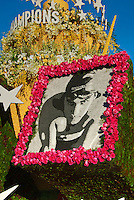 Olympic Swimming Gold Medalist Michael Phelps; lush gardens on the float,  Rose Parade, Tournament of Roses, Pasadena;