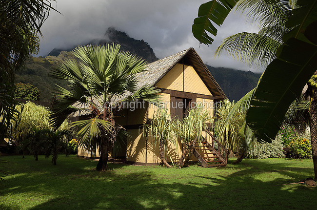 Reconstruction of the Maison du Jouir or House of Pleasure, home to French artist Paul Gauguin, 1848-1903, from 1901 to his death, now part of the Paul Gauguin Cultural Center, a museum which opened in 2003, in Atuona, on the island of Hiva Oa, in the Marquesas Islands, French Polynesia. The building is a traditional 2-storey hut with a wooden lintel carved by Gauguin in 1901 with the inscription, 'Be mysterious. Be loving and you will be happy'. Picture by Manuel Cohen