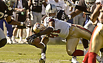 San Francisco 49ers wide receiver Terrell Owens (81) dives to make extra yards on Sunday, November 3, 2002, in Oakland, California. The 49ers defeated the Raiders 23-20 in an overtime game.