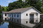 8/15/11} Vicksburg} -- Jesus had to walk on water to get to church today in the Kings Community of Vicksburg Mississippi Sunday May 15,2011. Pastor Maxwell checks out the flood waters outside the Cool Springs Church Sunday.The mighty Mississippi River threatens to flood CoolSprings Church in the Kings Community, most of the congregations homes are flooded, but many showed up early Sunday May 15, 2011 for church services. PHOTO©SUZI ALTMAN.COM.Photo by Suzi Altman.