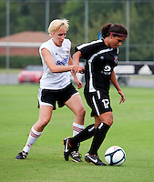 Yasmin Bunter (17) of the Virginia Beach Piranhas holds the ball away from Julia Bizer (11) of the Fredericksburg Impact during the game at the University of Mary Washington Battleground Stadium in Fredericksburg, VA.   The Virginia Beach Piranhas defeated the Fredericksburg Impact, 2-0, in a weather shortened game.
