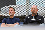 09 September 2014: New York City FC head coach Jason Kreis (left) and Carolina RailHawks head coach Colin Clarke (NIR) (right) scout the game. The Duke University Blue Devils hosted the Temple University Owls at Koskinen Stadium in Durham, North Carolina in a 2014 NCAA Division I Men's Soccer match. Duke won the game 3-1.