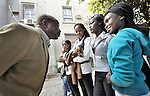 Refugee girls talk with a teacher in a school operated by St. Andrew's Refugee Services in Cairo, Egypt. The school is supported by Church World Service.