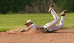 BEACON FALLS,  CT-051817JS27-Woodland's Zack Bedryczuk (12) makes a diving attempt for a ground ball during their game against Wolcott Thursday at Woodland Regional High School in Beacon Falls. <br /> Jim Shannon Republican-American