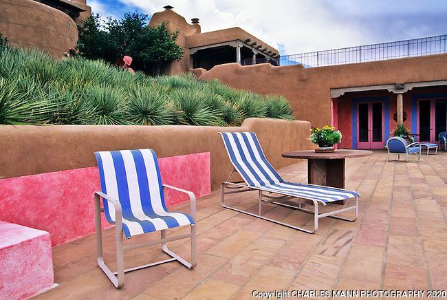 Designed by Martha Schwartz of Boston, the garden of Nancy dickenson n Santa Fe has a number of modernistic elements inclding c0olord walls and tile embellished canals and fountains.