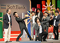 Comedians from Yoshimoto Agency take photos of themselves and Masayoshi Son, chairman and CEO of Softbank, during the company?s launch of its new mobile handsets before 3,500 specially invited guests in Tokyo. 16 February, 2009. (Taro Fujimoto/JapanToday/Nippon News)