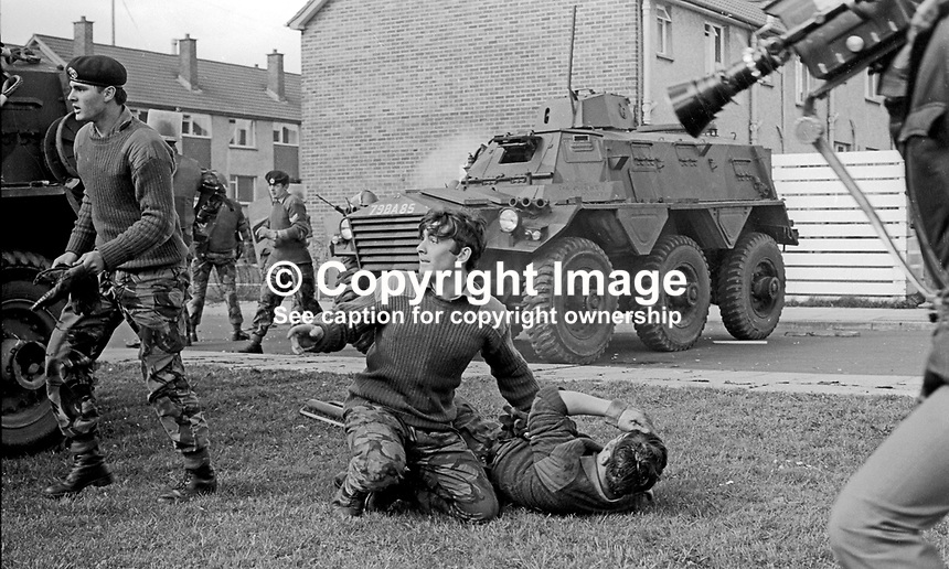 Soldier calls for medical assistance for a colleague injured during rioting in the Roman Catholic Lenadoon public housing estate in West Belfast, N Ireland, 9th July 1972. The disturbances occured after it was claimed that Roman Catholics tried to take over public housing in a nearby Protestant estate. TV news cameramen was on the scene. 197207090379n<br />