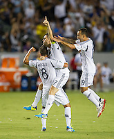 CARSON, CA - August 31, 2013: Los Angeles Galaxy forward Robbie Keane (7) and teammates Marcelo Sarvas (8) and Juninho (19) celebrating Keane's goal during the LA Galaxy vs San Jose Earthquakes match at the StubHub Center in Carson, California. Final score, LA Galaxy 3, San Jose Earthquakes  0.