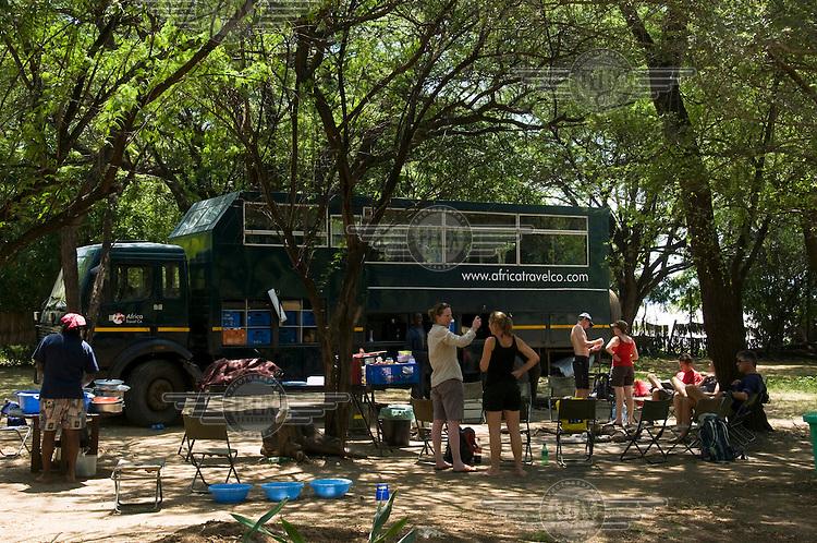 International overland safari tourists on Roberts campsite on the shore of Lake Baringo.