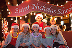 Youth from Saint Nicholas School pose for a photo before the start of the parade.