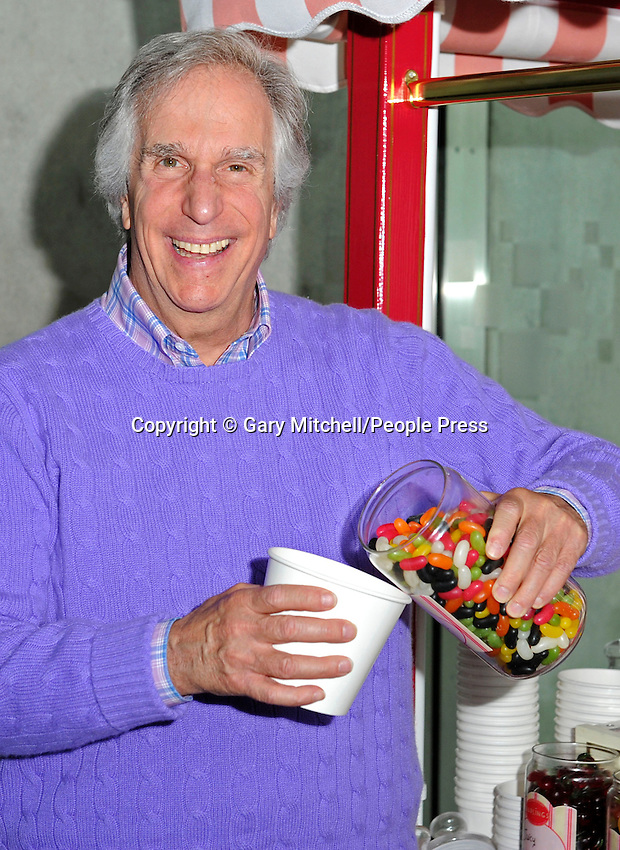 Milton Keynes, UK -  Actor and dyslexic author Henry Winkler - aka 'The Fonz' - meets children from local schools in Milton Keynes. .Henry is touring schools and theatres with Nicky Cox, editor of children's newspaper First News as part of the '2013 First News My Way' campaign, in partnership with Charity, Achievement for All 3As. .Pictured - Henry Winkler, Milton Keynes Theatre, Bucks, UK - 8th March 2013..Photo by Gary Mitchell