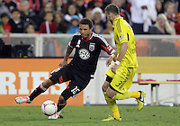WASHINGTON, DC - OCTOBER 20, 2012:  Nick DeLeon (18) of D.C United cuts inside Josh Williams (3) of the Columbus Crew during an MLS match at RFK Stadium in Washington D.C. on October 20. D.C United won 3-2.