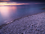 Beautiful sunset scenery of Georgian Bay pebble shore. Bruce Peninsula National Park, Ontario, Canada.