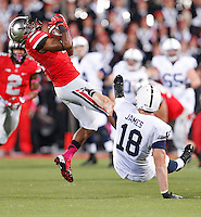 Ohio State Buckeyes safety C.J. Barnett (4) comes down with an interception meant for Penn State Nittany Lions tight end Jesse James (18) in the second quarter at Ohio Stadium on October 26, 2013.  (Chris Russell/Dispatch Photo)