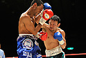 (L-R) Celestino Caballero (PAN), Satoshi Hosono (JPN), DECEMBER 31, 2011 - Boxing : Satoshi Hosono of Japan in action against Celestino Caballero of Panama during the WBA featherweight title bout at Yokohama Cultural Gymnasium in Kanagawa, Japan. (Photo by Hiroaki Yamaguchi/AFLO)