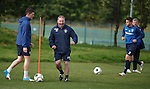 Ally McCoist shows his players how it's done as he zips past them in training