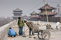Workmen carry out repair work on The City Wall, Xian, China