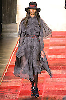 Jourdan Dunn walks runway in an outfit from the Tommy Hilfiger Fall 2011 Bohemian Prep collection, during Mercedes-Benz Fashion Week Fall 2011.