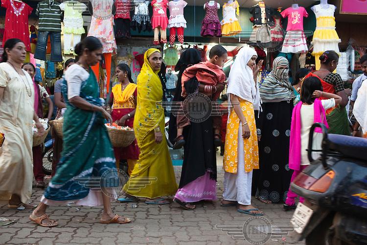 Women shopping at a local market in Dharavi slum.