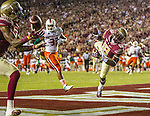 Florida State wide receiver Auden Tate (18) watches a pass he missed in the end zone as his teammate Ermon Lane having a second chance for the touchdown catch but misses too in the first half of an NCAA college football game against Miami in Tallahassee, Fla., Saturday, Oct. 10, 2015.   The Florida State Seminoles defeated the Miami Hurricanes 29-24.