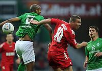 FUSSBALL   1. BUNDESLIGA   SAISON 2011/2012    12. SPIELTAG SV Werder Bremen - 1. FC Koeln                              05.11.2011 NALDO (li, Bremen) gegen Lukas PODOLSKI (re, Koeln)