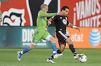 D.C. United forward Dwayne De Rosario (7) shields the ball against Seattle Sounders midfieler Osvaldo Alonso (6)  D.C. United tied the Seattle Sounders, 0-0 at RFK Stadium, Saturday April 7, 2012.