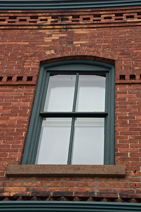 Detail of a red brick building in downtown Marquette Michigan.