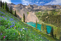 From just outside Ouray, Colorado, the Blue Lakes hike is one of the prettiest in state. To reach the lower lake, it is a nice 3.3 mile hike. But if you go this far, you need to continue on to the Middle and Upper Lakes. This view is just above Lower Blue Lake. The steep slopes of this alpine wonder are  filled with colorful Colorado wildflowers in July, making for an amazing view at ~ 11,500 feet.