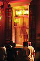 A woman dancing in the window of Temptations on Bourbon Street, 2002