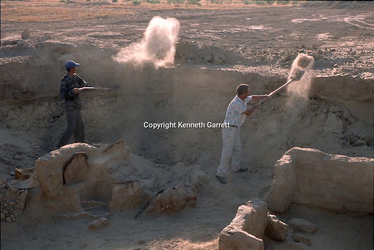 Excavation of royal tomb with cart being cleaned out; Oxus Civilization; Turkmenistan; Gonor Depe site; Victor Sarianidi; Archaeology; BMAC complex