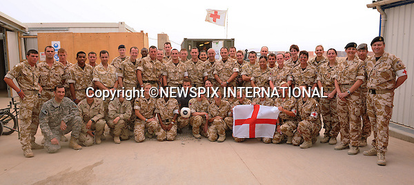 "DAVID BECKHAM.poses with troops from the UK Role 3 Hospital, in camp Bastion Afghanistan..David Beckham paid a surprise goodwill visit to UK and US troops in Camp Bastion. He met with hundreds of soldiers and gave away signed England shirts and memorabilia. He was, he said, 'overwhelmed' by the stories of courage he heard..Beckham arrived on Friday night on a Royal Air Force C17 aircraft, stepping off into 45 degree heat in body armour and helmet..After a night's sleep, he ate breakfast in the cookhouse, moving from table to table signing autographs and having photographs taken_Camp Bastion, Helmand Province, Afghanistan_22/05/2010.Photo Credit: ©LLoyd_Newspix International..**ALL FEES PAYABLE TO: ""NEWSPIX INTERNATIONAL""**..PHOTO CREDIT MANDATORY!!: NEWSPIX INTERNATIONAL..IMMEDIATE CONFIRMATION OF USAGE REQUIRED:.Newspix International, 31 Chinnery Hill, Bishop's Stortford, ENGLAND CM23 3PS.Tel:+441279 324672  ; Fax: +441279656877.Mobile:  0777568 1153.e-mail: info@newspixinternational.co.uk"