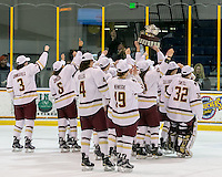 North Andover, Massachusetts - March 6, 2016: NCAA Division I, Women's Hockey East final. Boston College (white/maroon) defeated Boston University (red), 5-0, at Lawler Arena at Merrimack College. Boston College has a perfect Hockey East season - regular season, Bean Pot winner, and Women's Hockey East winner. Showing cup to loyal fans.