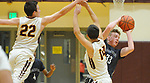 Eagle River's Bryson Rollman finds a way for an outlet pass against Dimond defenders Nicolas Horning and Jesse Boese.  Photo for the Star by Michael Dinneen