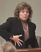 Doctor Mary G. Ripple, assistant chief medical examiner for the state of Maryland, gestures as she describes the wounds of sniper victim Conrad Johnson during the trial of sniper suspect John Allen Muhammad in courtroom 10 at the Virginia Beach Circuit Court in Virginia Beach, Virginia on November 3, 2003.<br /> Credit: Lawrence Jackson - Pool via CNP