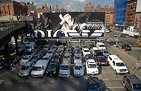 A billboard for Emporio Armani is seen from the new High Line Park in the New York neighborhood of Chelsea on Tuesday, August 26, 2009. The park, utilizing the railbed of the former High Line which ceased operation in 1980, has finished the first phase of its transformation into a 1.5 mile park running north from the trendy Meatpacking District. The original High Line, opened in 1934, traveled from West 35th, connecting with the railyards, down to Houston Street, traveling through the center of buildings where goods could be loaded and unloaded. The park officially opens to the public on June 9, 2009.  (© Richard B. Levine)