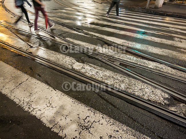 Painted crosswalk bars and rails, trolley tracks, and crosswalk along Alexander Boulevard, Streets at night in Belgrade, Serbia