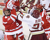 Joe Pereira (BU - 6) collides with Patch Alber (BC - 27) while celebrating his goal. - The Boston College Eagles defeated the visiting Boston University Terriers 5-2 on Saturday, December 4, 2010, at Conte Forum in Chestnut Hill, Massachusetts.