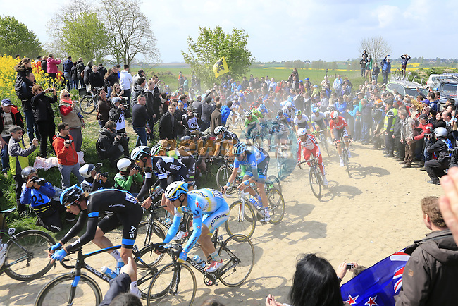 The peleton pass over the Quievy to Saint-Python pave sector during the 112th edition of the 257 km Paris-Roubaix cycle race held over the cobbled roads of Northern France. 13th April 2014.<br /> Picture: Eoin Clarke www.newsfile.ie