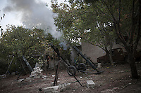 In this Tuesday, Oct. 08, 2013 photo, shows a piece of mortar artillery being shell during an attack by opposition fighters (not pictured) over Wadi Al-Deef military post at the frontline in Maraat Al-Nouman in the Idlib province countryside of Syria. (AP/Photo)