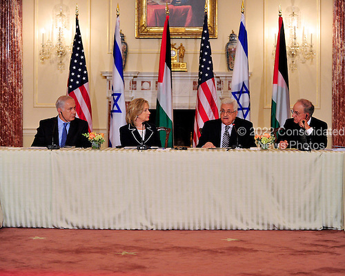 """President Mahmoud Abbas of the Palestinian Authority makes remarks at the """"Relaunch of Direct Negotiations Between the Israelis and Palestinians"""" in the Benjamin Franklin Room of the U.S. Department of State on Thursday, September 2, 2010.  From left to right: Prime Minister Benjamin Netanyahu of Israel, United States Secretary of State Hillary Rodham Clinton, President Mahmoud Abbas of the Palestinian Authority, and U.S. Special Envoy to the Middle East George Mitchell..Credit: Ron Sachs / CNP.(RESTRICTION: NO New York or New Jersey Newspapers or newspapers within a 75 mile radius of New York City)"""