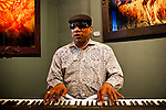 Henry Butler performing at an exhibit of his photographs at A Gallery for Fine Photography in New Orleans, Louisiana, April 27, 2011.