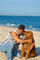 Man being licked by a Golden Retriever <br />