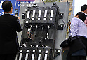 October 12, 2011, Yokohama, Japan - Toshiba displays batteries for electric vehicles during Electric Vehicle Development Technology Exhibition 2011 in Yokohama, south of Tokyo, on Wednesday, October 12, 2011. EVEX covers all EV-related processes from materials and design to completion. The trade show also provides rare opportunities to see and experience a trial ride the lates EVs. (Photo by Natsuki Sakai/AFLO) [3615] -mis-