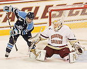 John Muse (BC - 1) stops Joey Diamond (Maine - 39). - The Boston College Eagles defeated the visiting University of Maine Black Bears 4-1 on Sunday, November 21, 2010, at Conte Forum in Chestnut Hill, Massachusetts.