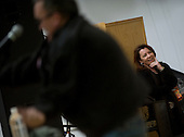 Mosul, Iraq - December 19, 2008 -- Comedian Kathleen Madigan listens as John Bowman introduces her to service members stationed during the 2008 USO Holiday Tour stop in Mosul, Iraq, Friday, December 19, 2008. United States Navy Admiral Mike Mullen, chairman of the Joint Chiefs of Staff along with his wife Deborah, welcomed comedian Lewis Black; actress Tichina Arnold; American Idol contestant and country musician Kellie Pickler and Grammy award winning musician Kid Rock on the tour bringing music and entertainment to service members and their families stationed overseas. (DoD photo by Mass Communication Specialist 1st Class Chad J. McNeeley/Released).Credit: Chad J. McNeeley - DoD via CNP
