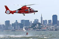 A swimmer is raised from the waters of San Francisco Bay by a United States Coast Guard HH-65C Dolphin helicopter. The helicopter and crew, based at U.S. Coast Guard Air Station San Francisco, was on a practice mission with the Coast Guard Auxilary to maintain search and rescue proficiency. Photographed 04/08