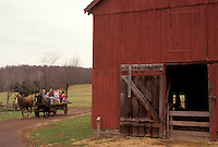 AJ3285, hay ride, barn, New Jersey, Living History Farm, A team of horses pulls a wagon load of people next to a red barn at the Howell Living History Farm in Lambertville in the state of New Jersey.