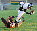 Cannon wide receiver Mike Brown steps over a Valley Tiger defender.to make the score.  Brown was picked up by the Cannons this.year to become a shining light for the team according to his coaches.